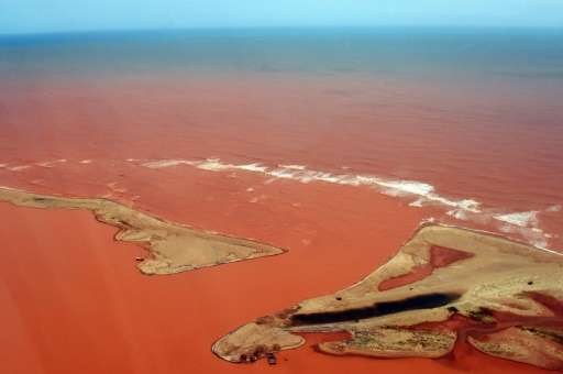 The Doce River, pictured on November 24, 2015, is seen flooded with mud and waste water after a dam owned by Vale SA and BHP Bil