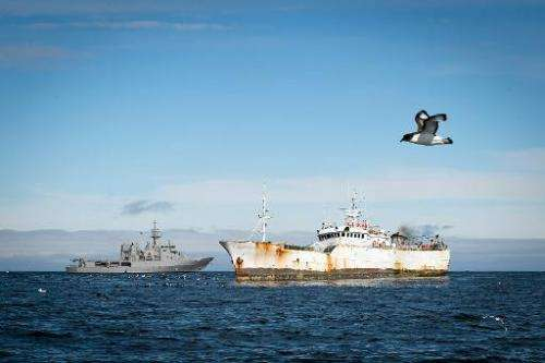 The HMNZS Wellington (L) is seen in a standoff with the suspected poaching ship Kunlun in Antarctic waters, January 14, 2015 in