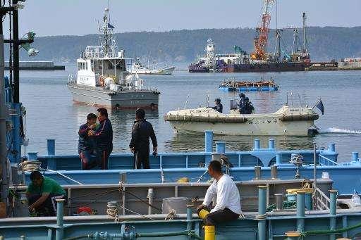The Japan Coast Guard patrols Ayukawa port as a whaling fleet departs from Ishinomaki City on April 26, 2014