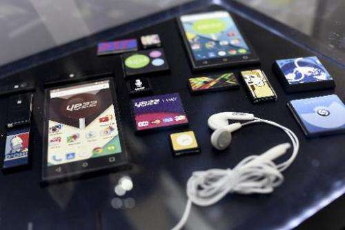 """The mobile device """"Ara"""" by Yezz with other gadgets during the 2015 Mobile World Congress in Barcelona on March 3, 2015"""
