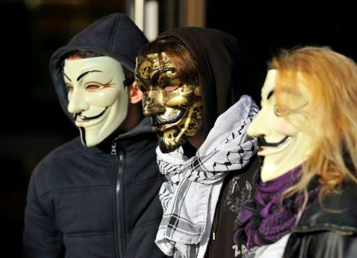 """The """"Anonymous"""" hackers collective, represented here by mask-wearing demonstrators at a French trial November 9, 2015,"""