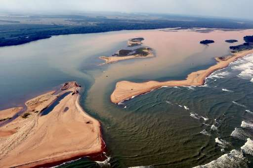 The Rio Doce,pictured on November 23, 2015, is seen flooded with mud and waste water after a dam owned by Vale SA and BHP Billit