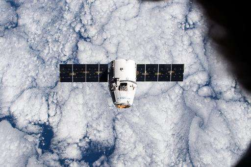 The SpaceX Dragon cargo craft approaches the International Space Station on a mission in January 2015