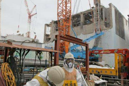 The unit four (right) and unit three (left) reactor buildings at the Fukushima Dai-Ichi nuclear power plant on March 1, 2013