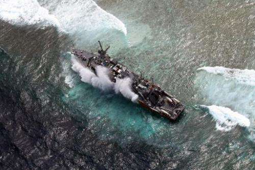 The USS Guardian, a US Navy minesweeper, is pictured trapped on the Tubbataha Reef in January 2013