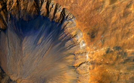 """This NASA/JPL/University of Arizona image obtained June 7, 2015 shows a close-up of a """"fresh"""" impact crater in the Sir"""