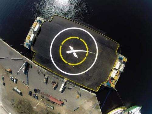 "This undated SpaceX photo obtained January 5, 2015 shows SpaceX's ""autonomous spaceport drone ship"" floating in the At"