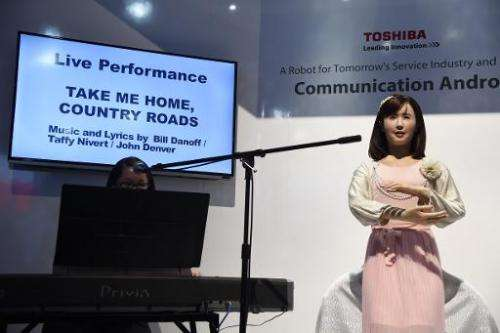 """Toshiba's """"Communication Android"""" robot named Chihira Aico sings John Denver's classic song """"Take Me Home Country"""