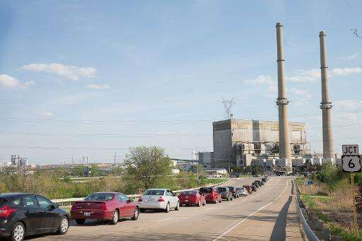 Traffic backs up at an intersecton in front of a power plant in Joliet, Illinois on May 7, 2015