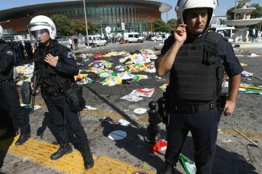 Turkish riot police forces secure the site of twin explosions near the main train station in Turkey's capital Ankara, on October