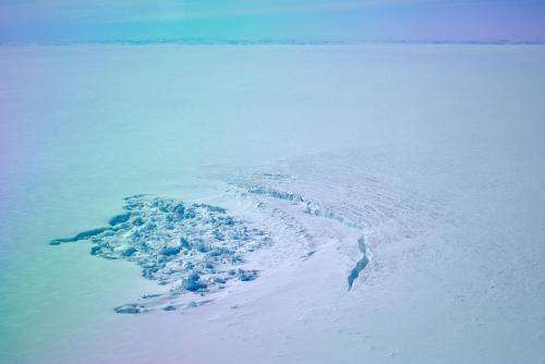 Two lakes beneath the ice in Greenland, gone within weeks