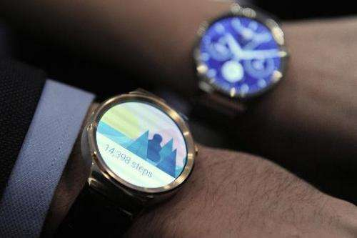 "Two models show the new Huawei's device ""Huawei Watch"" during a press conference in Barcelona, Spain, on March 1, 2015"