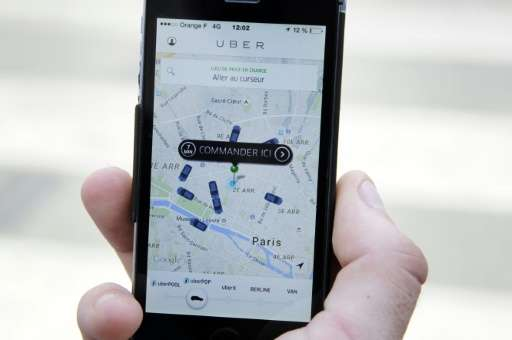 Two top Uber bosses were taken into custody in France Monday as part of a probe into their ride-booking app which has sparked vi