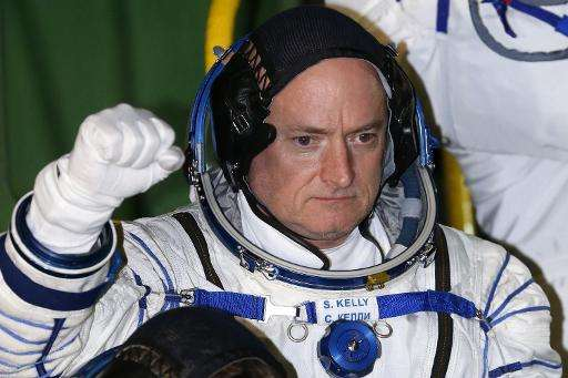 US astronaut Scott Kelly boards the Soyuz TMA-16M spacecraft on March 27, 2015, before blasting off from the launch pad at the B