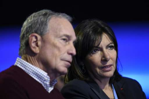 "US billionaire Michael Bloomberg talks to Paris Mayor Anne Hidalgo during a working session for ""Action Day"" at the CO"