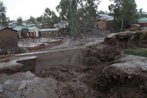 Water floods the streets of a township on the outskirts of Blantyre, Malawi, on January 12, 2015