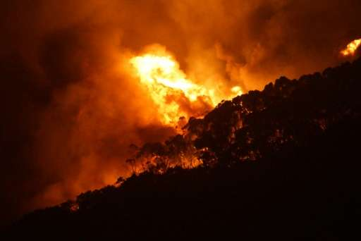 Wildfires in Australia fanned by hot, dry conditions have engulfed more than 100 homes outside Melbourne