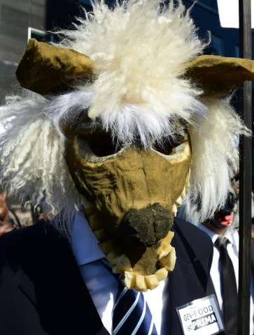 A demonstrator dressed as a genetically modified monster takes part in an anti-GM rally in Berlin