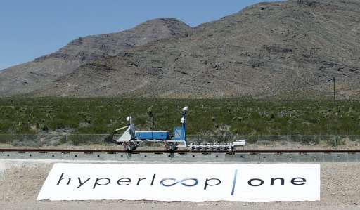 A recovery vehicle pushes a test sled is after it was propelled along a set of tracks during its first propulsion open air test