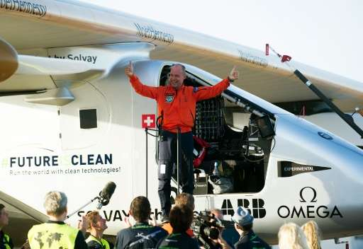 Bertrand Piccard celebrates at Sevilla airport on June 23, 2016, after the 70-hour sun-powered journey from New York