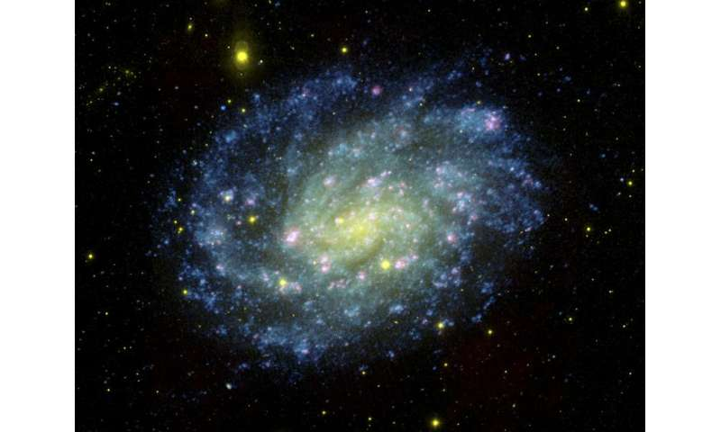 Caught in the act: UW astronomers find a rare supernova 'impostor' in a nearby galaxy
