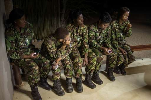 "Female members of the anti-poaching team ""Black Mambas"" conduct a routine patrol through a wildlife reserve on Septemb"