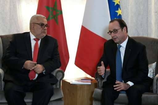 French President Francois Hollande (R) meets Moroccan Prime Minister Abdelilah Benkirane on the sidelines of the COP22 Climate C