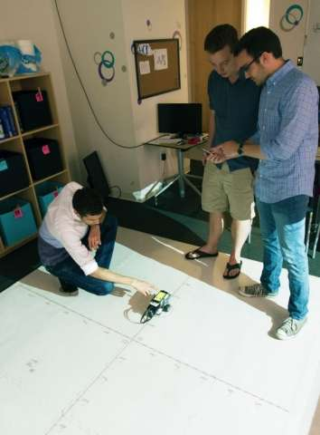 Grade-school students teach a robot to help themselves learn geometry