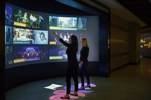 Interactive digital walls offer art and info in hotel lobby