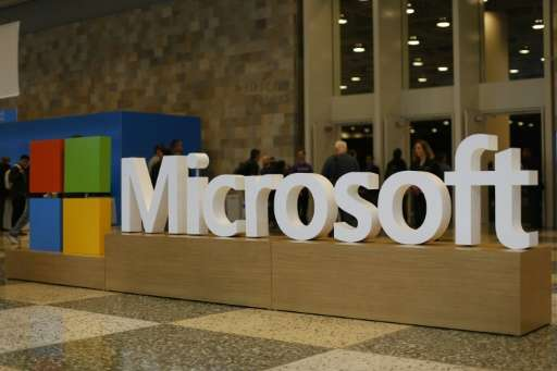 Microsoft posted a net profit of $4.7 billion, down four percent from a year earlier, on revenue that remained essentially flat