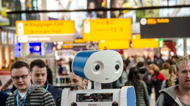 Robot spencer accompanies first passengers at Schiphol airport