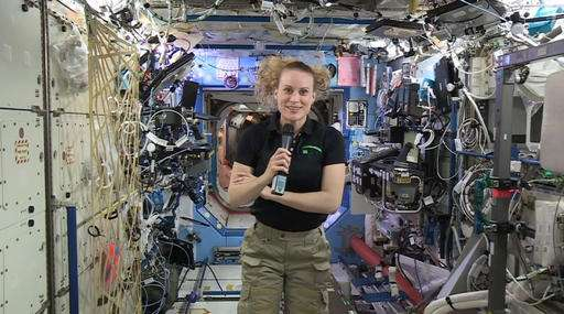 US astronaut will vote from orbit if homecoming is delayed