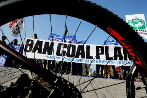 Environmentalists take part in a bicycle ride to show solidarity for the global movement for climate justice, in Manila, in Dece