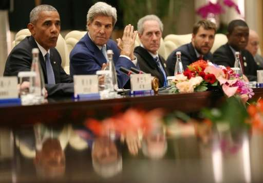 US President Barack Obama and US Secretary of State John Kerry attend a meeting ahead of the G20 summit in Hangzhou, China