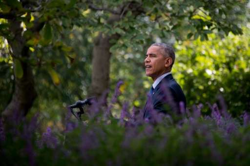 US President Barack Obama speaks about the Paris Agreement from the Rose Garden of the White House in Washington, DC, October 5,