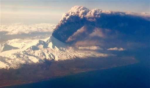 Alaska volcano spews smaller amounts of ash at lower levels (Update)