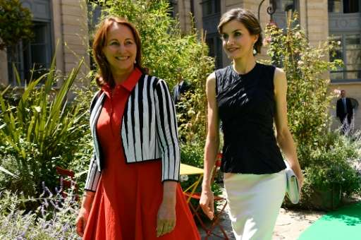 French Environment Minister Segolene Royal (L) and Spain's Queen Letizia walk during the opening of the 2nd Global Conference on