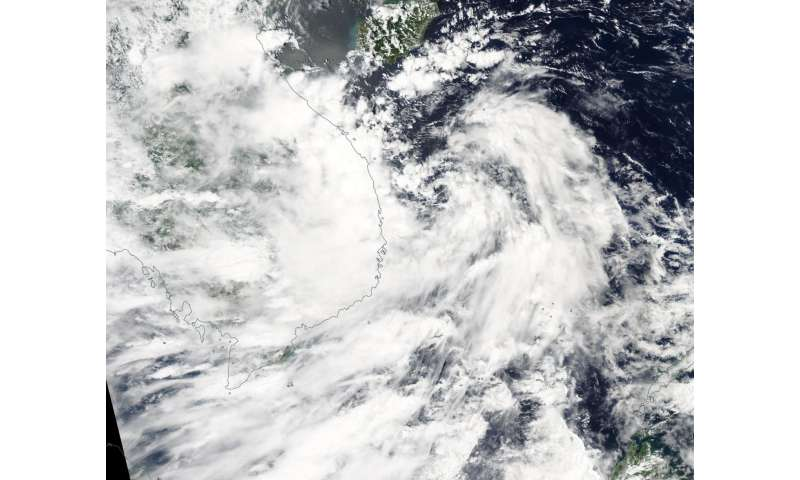 NASA catches Tropical Depression 19W nearing Vietnam after formation
