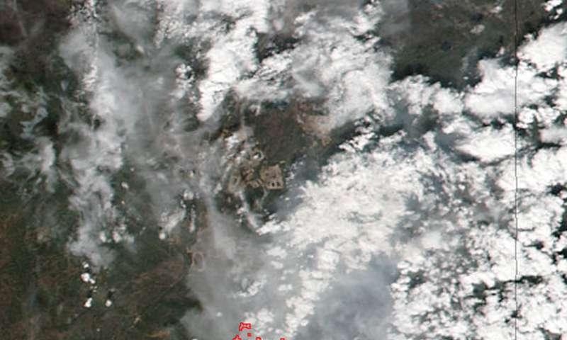 NASA-NOAA's Suomi NPP satellite sees massive Alberta wildfire day and night