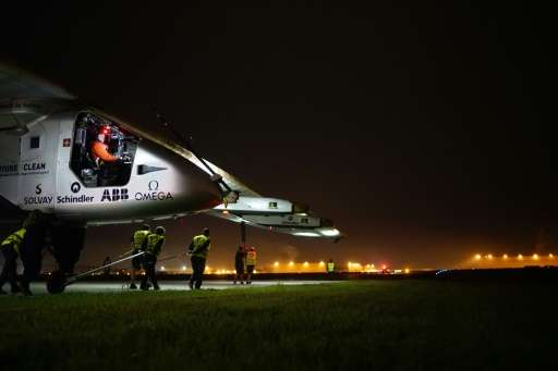 Solar Impulse 2 workers tow the experimental solar-powered aircraft to the runway in Tulsa, Oklahoma, on May 21, 2016