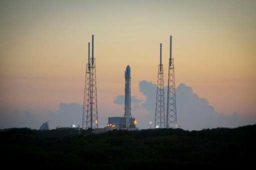 The SpaceX Falcon 9 rocket sits on the launch pad at Cape Canaveral, Florida