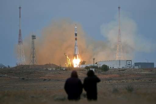 A Russian Soyuz MS-02 spacecraft carrying a crew to the International Space Station blasts off from the Russian-leased Baikonur