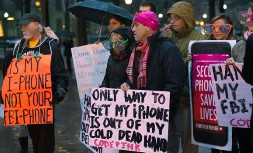 Protesters demonstrate outside the Federal Bureau of Investigation headquarters building in Washington, DC, in February 2016, ob