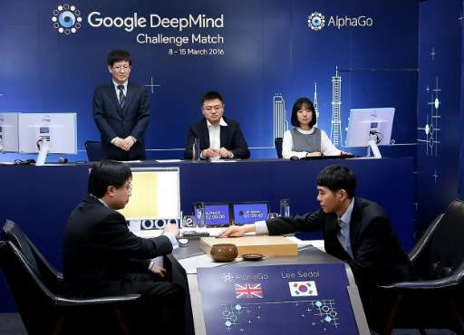 South Korean Go grandmaster Lee Se-Dol (R) makes a move during the first in a five-game series against AlphaGo in Seoul on March