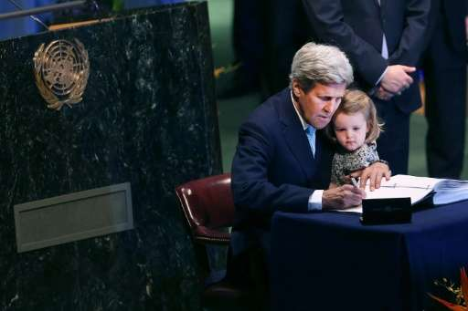 US Secretary of State John Kerry holds his granddaughter at the UN Signing Ceremony for the Paris climate accord in April