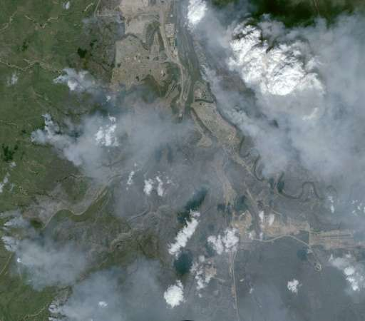 An aerial view taken on May 6, 2016 by the satellite Pleiades of wildfires in Fort McMurray in Canada