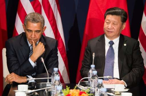 US President Barack Obama (L) sits with Chinese President Xi Jinping during a bilateral meeting ahead of the opening of the UN c