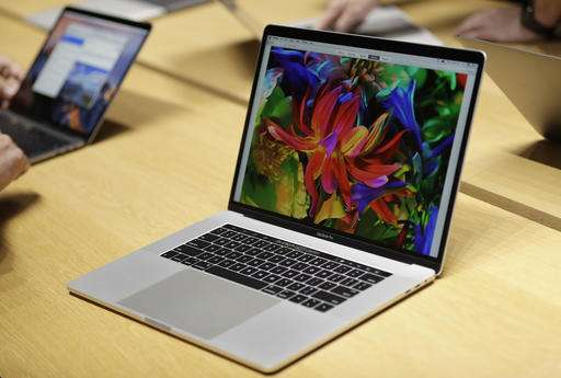 New Macs, Lenovo laptop make traditional keyboards touchy