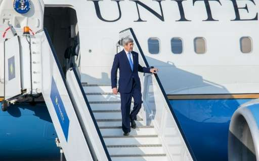 US Secretary of State John Kerry disembarks from his plane at Kigali International Airport on October 13, 2016