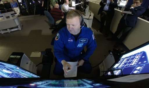 NASA astronauts prepare for flight on commercial spacecraft